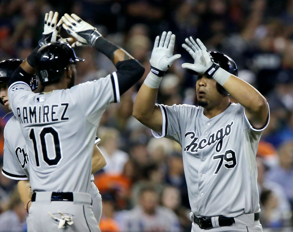 . Chicago White Sox\'s Jose Abreu is congratulated by Alexei Ramirez after hitting a two run home run off of Detroit Tigers pitcher Joakim Soria during the seventh inning of a baseball game Tuesday, July 29, 2014, in Detroit. (AP Photo/Duane Burleson)