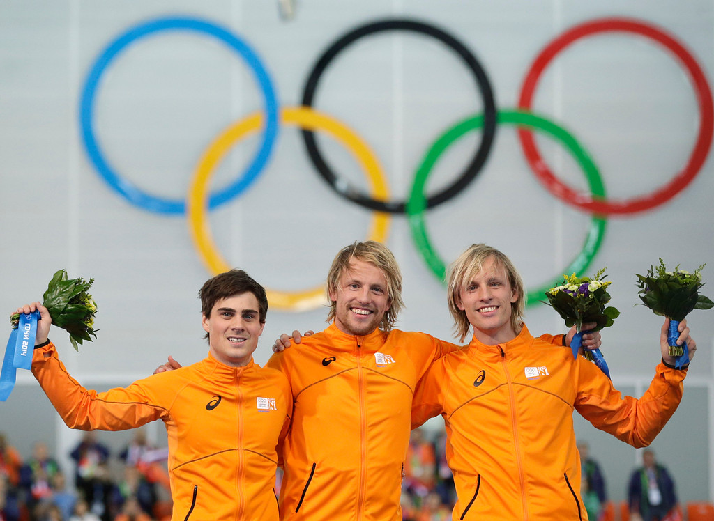 . Athletes from the Netherlands, from left to right, Silver medallist Jan Smeekens, gold medallist Michel Mulder and bronze medallist Ronald Mulder stand on the podium during the flower ceremony for the men\'s 500-meter speedskating race at the Adler Arena Skating Center at the 2014 Winter Olympics, Monday, Feb. 10, 2014, in Sochi, Russia.  (AP Photo/Patrick Semansky)