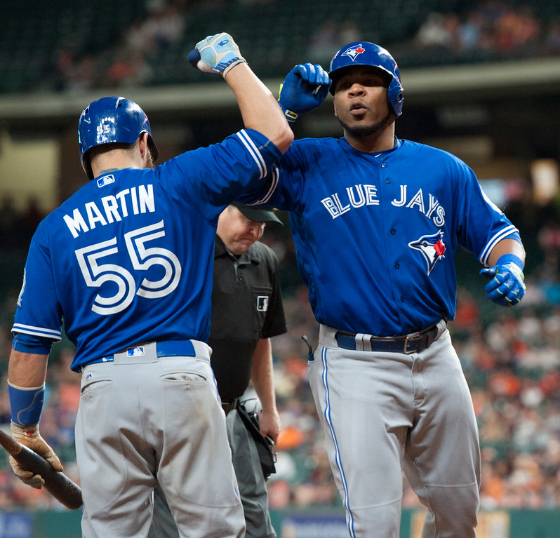 . Toronto Blue Jays\' Edwin Encarnacion, right, celebrates a solo home run against the Houston Astros with  Russell Martin during the ninth inning of a baseball game Thursday, Aug. 4, 2016, in Houston. (AP Photo/George Bridges)