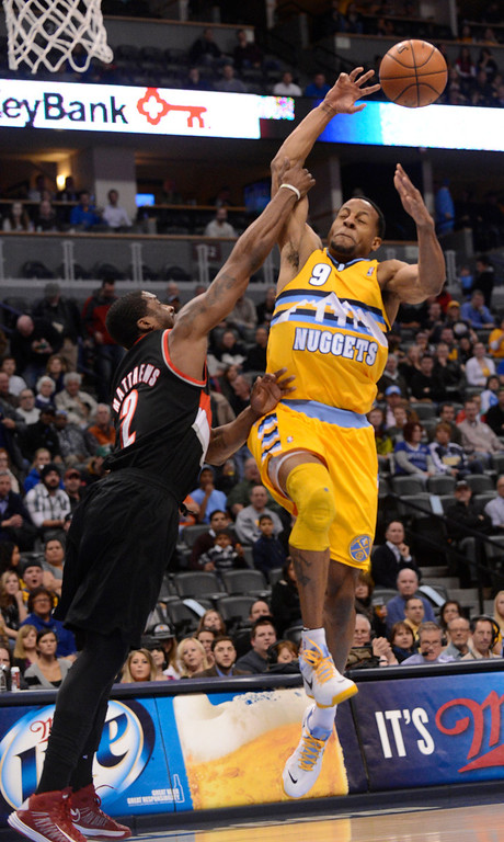 . Denver Nuggets shooting guard Andre Iguodala (9) gets fouled by Portland Trail Blazers shooting guard Wesley Matthews (2) during the first quarter  Tuesday, January 15, 2013, at Pepsi Center. John Leyba, The Denver Post