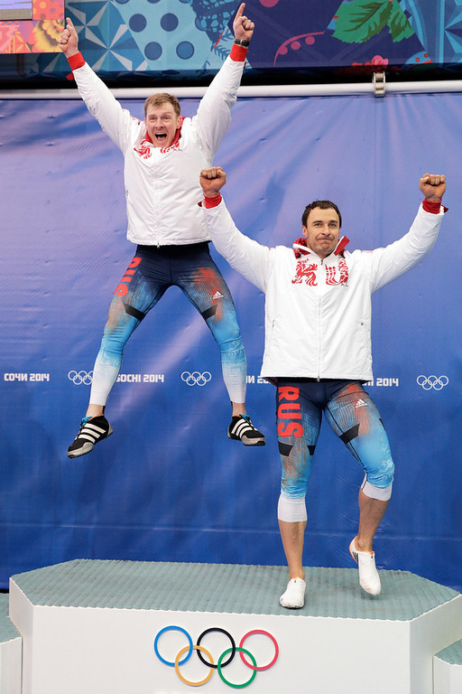. Gold medalists Alexander Zubkov and Alexey Voevoda of Russia team 1 celebrate during the flower ceremony for the Men\'s Two-Man Bobsleigh on Day 10 of the Sochi 2014 Winter Olympics at Sliding Center Sanki on February 17, 2014 in Sochi, Russia.  (Photo by Adam Pretty/Getty Images)