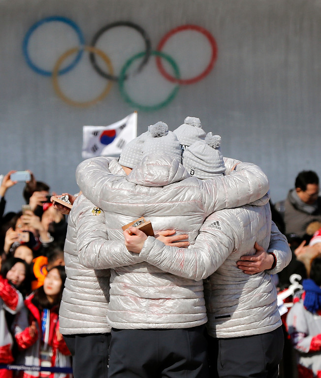 . Driver Francesco Friedrich, Candy Bauer, Martin Grothkopp and Thorsten Margis of Germany celebrate after receiving the gold medal during the four-man bobsled competition final at the 2018 Winter Olympics in Pyeongchang, South Korea, Sunday, Feb. 25, 2018. (AP Photo/Andy Wong)