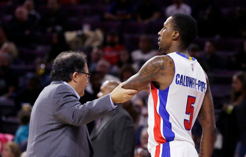 . Detroit Pistons head coach Stan Van Gundy walks guard Kentavious Caldwell-Pope back to the bench after Caldwell-Pope\'s pushing encounter with Phoenix Suns forward Markieff Morris during the first half of an NBA basketball game in Auburn Hills, Mich., Wednesday, Nov. 19, 2014. (AP Photo/Carlos Osorio)