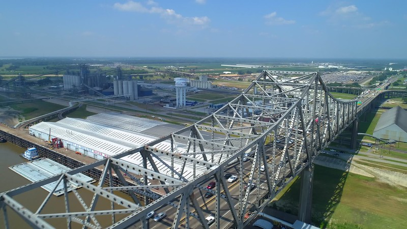 Aerial flyover and camera tilt down over metal bridge
