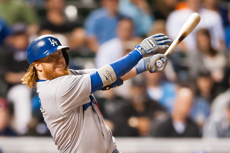 . Justin Turner #10 of the Los Angeles Dodgers hits a go-ahead, two-run double in the sixth inning of a game at Coors Field on September 15, 2014 in Denver, Colorado.  (Photo by Dustin Bradford/Getty Images)