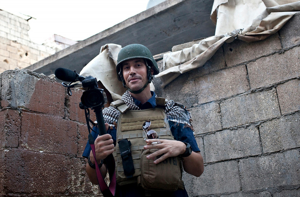 . In this November 2012, file photo, posted on the website freejamesfoley.org, shows American journalist James Foley while covering the civil war in Aleppo, Syria. In a horrifying act of revenge for U.S. airstrikes in northern Iraq, militants with the Islamic State extremist group have beheaded Foley � and are threatening to kill another hostage, U.S. officials say. (AP Photo/freejamesfoley.org, Nicole Tung, File) NO SALES