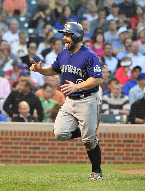 . CHICAGO, IL - JULY 30:  Michael McKenry #8 of the Colorado Rockies reacts after scoring against the Chicago Cubs during the second inning on July 30, 2014 at Wrigley Field in Chicago, Illinois. (Photo by David Banks/Getty Images)