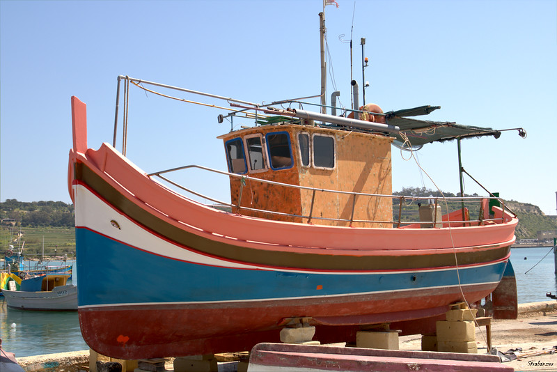 Malta.   Marsaxlokk Harbor   Luzzu in dry dock.    03/24/19.     This work is licensed under a Creative Commons Attribution- NonCommercial 4.0 International License