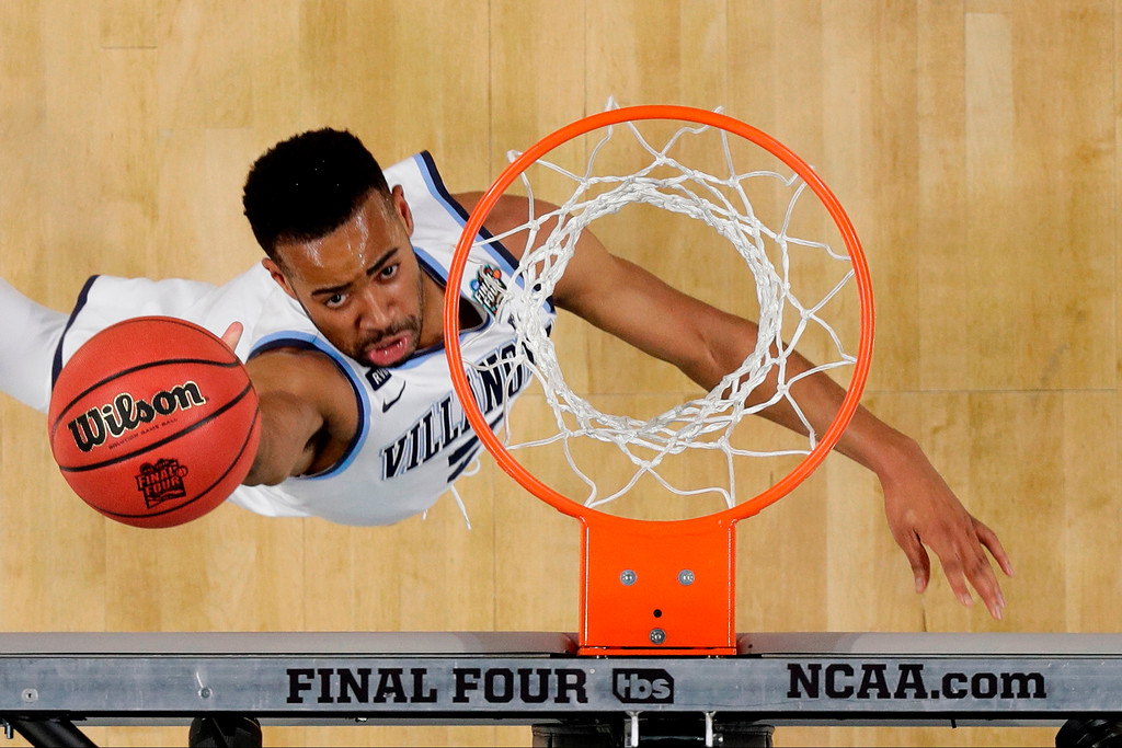 . Villanova guard Phil Booth drives to the basket during the first half against Michigan in the championship game of the Final Four NCAA college basketball tournament, Monday, April 2, 2018, in San Antonio. (AP Photo/Eric Gay)