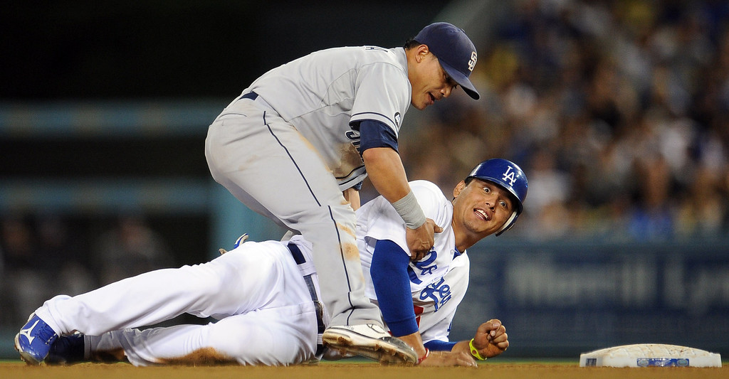 . Los Angeles Dodgers\' Luis Cruz reacts after being forced out at second base by San Diego Padres second baseman Logan Forsythe in the second inning of their baseball game on Wednesday, Sept. 5, 2012 in Los Angeles.   (Keith Birmingham/Pasadena Star-News)