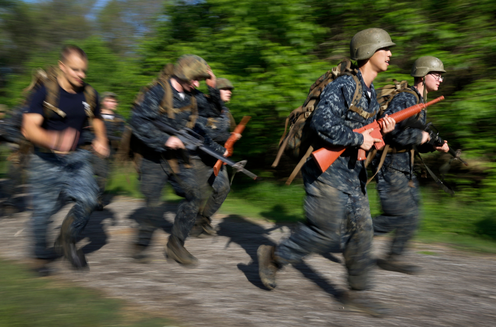 """. Freshman midshipmen, known as \""""plebes,\"""" march during Sea Trials, a day of physical and mental challenges that caps off the freshman year at the U.S. Naval Academy in Annapolis, Md., Tuesday, May 13, 2014. (AP Photo/Patrick Semansky)"""