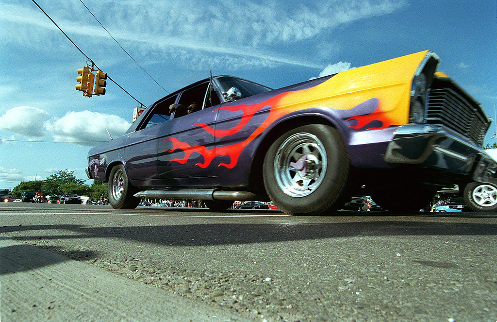 . A flame painted car called the Purple People Eater burns rubber on southbound Woodward at 13 mile during the Dream Cruise 2000 saturday afternoon.