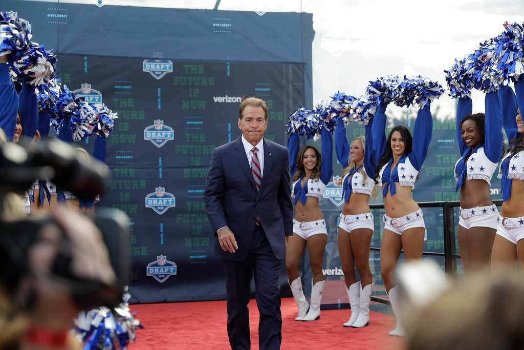 . Alabama head coach Nick Saban poses for photos on the red carpet before the first round of the NFL football draft, Thursday, April 26, 2018, in Arlington, Texas. (AP Photo/Eric Gay)