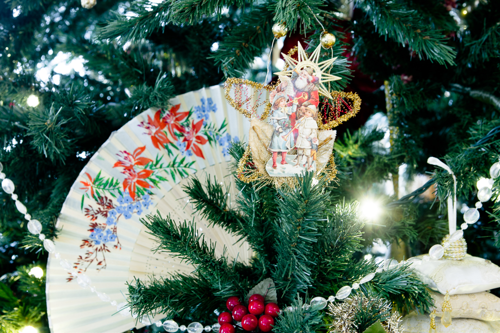 . Fans, garlands, and angel ornaments grace one of the many Christmas trees throughout the rooms of the Governor\'s mansion. Photo by Mark Broste
