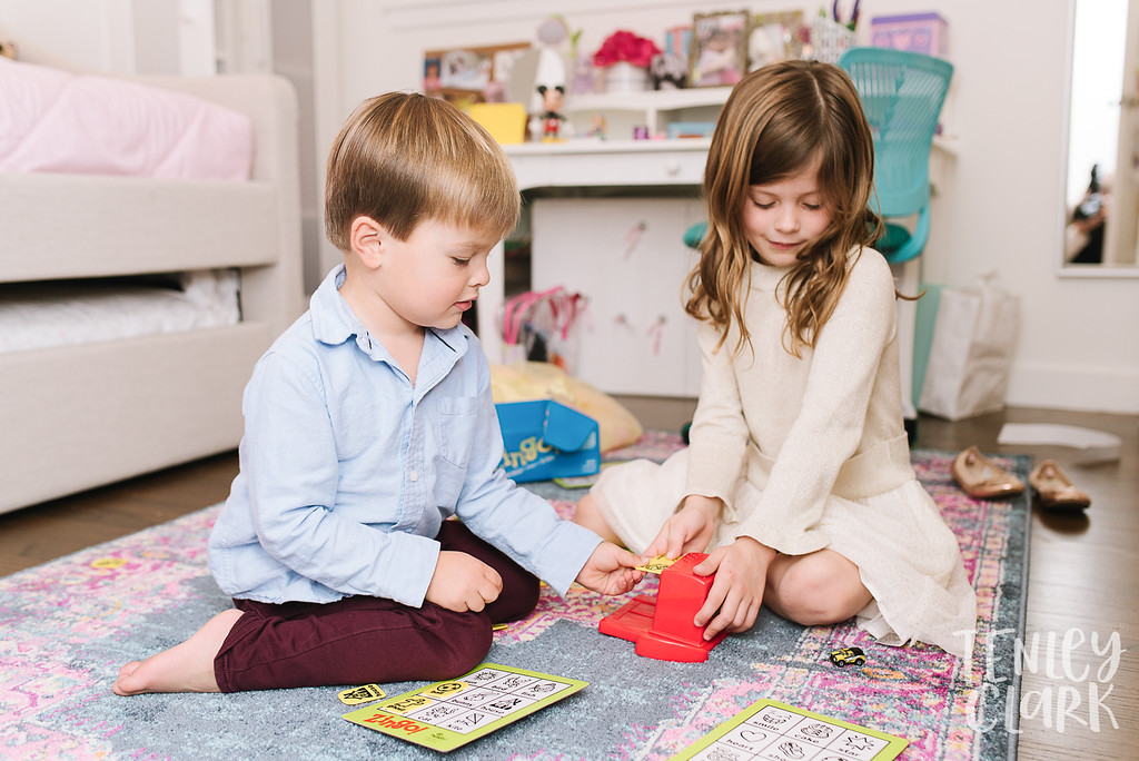 Kids playing Zingo in room. Lifestyle in-home family photoshoot in Marin, CA by Tenley Clark Photography.