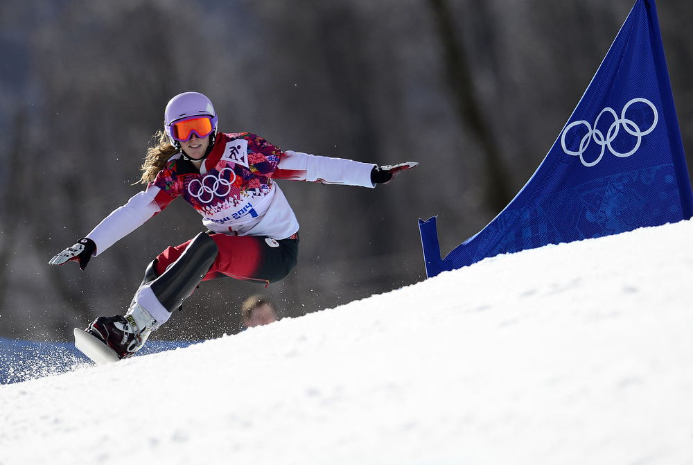 . Canada\'s Ariane Lavigne competes in the Women\'s Snowboard Parallel Giant Slalom Quarterfinals at the Rosa Khutor Extreme Park during the Sochi Winter Olympics on February 19, 2014.  JAVIER SORIANO/AFP/Getty Images