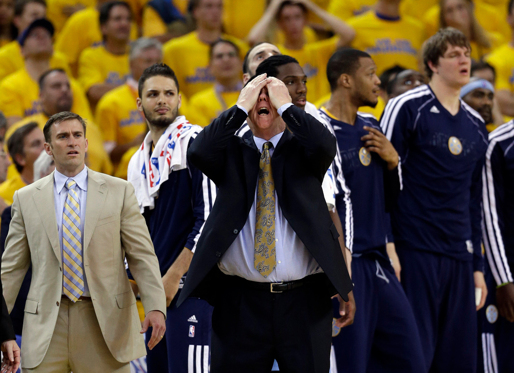 . Denver Nuggets head coach George Karl,  center, reacts in the closing seconds of a 92-88 loss to the Golden State Warriors during Game 6 in a first-round NBA basketball playoff series in Oakland, Calif., Thursday, May 2, 2013. (AP Photo/Marcio Jose Sanchez)