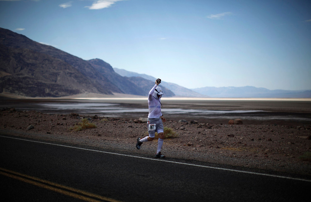 . Glen Redpath of Canada, 47, competes during the Badwater Ultramarathon in Death Valley National Park, California July 15, 2013. The 135-mile (217 km) race, which bills itself as the world\'s toughest foot race, goes from Death Valley to Mt. Whitney, California in temperatures which can reach 130 degrees Fahrenheit (55 Celsius).  REUTERS/Lucy Nicholson