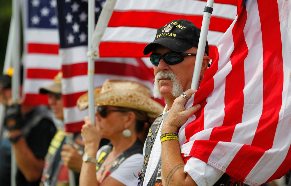 . A member of a veteran\'s group looks on during a Memorial Day ceremony at the South Florida National Cemetery in Lake Worth, Florida May 27, 2013. REUTERS/Joe Skipper