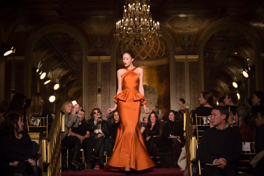 Description of . A model presents a creation at the Zac Posen Autumn/Winter 2013 collection during New York Fashion Week February 10, 2013. REUTERS/Andrew Kelly