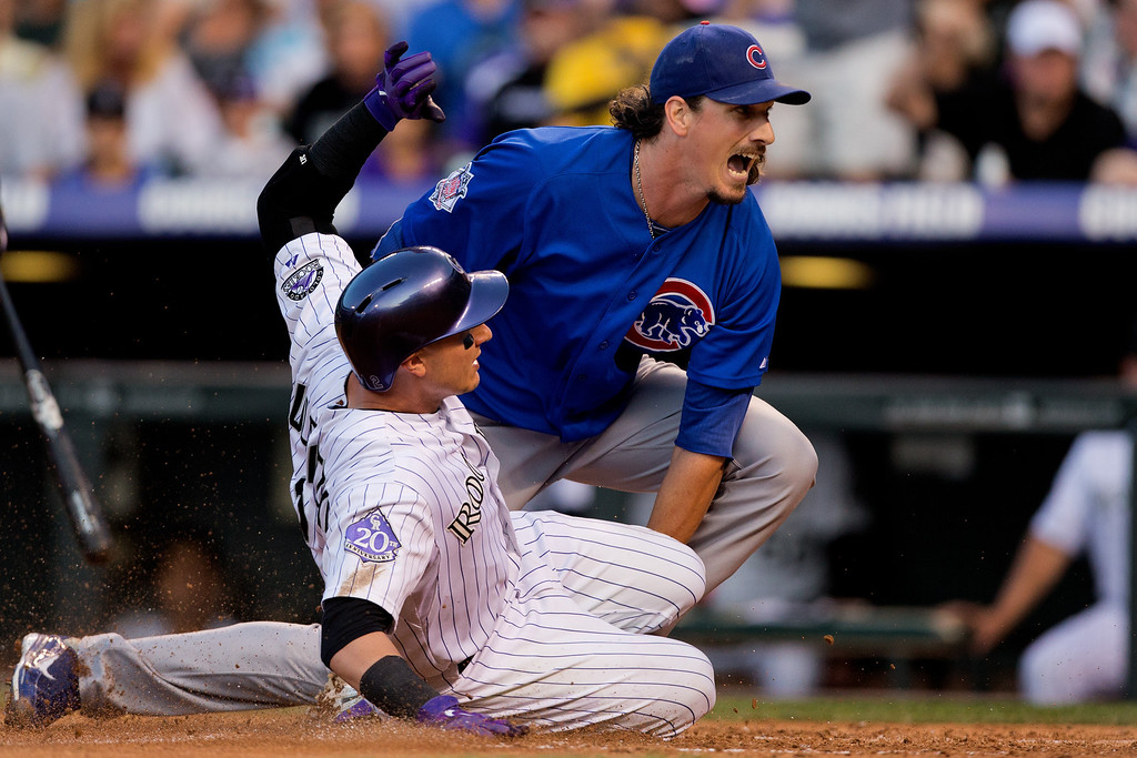 . DENVER, CO - JULY 19:  Jeff Samardzija #29 of the Chicago Cubs tags out Troy Tulowitzki #2 of the Colorado Rockies at home plate during the fourth inning at Coors Field on July 19, 2013 in Denver, Colorado.  (Photo by Justin Edmonds/Getty Images)