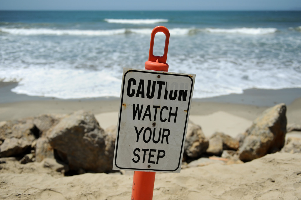 . Caution signs have been place in the sand at Hueneme Beach where sand has washed away during the past several months, Monday, July 15, 2013. (Michael Owen Baker/L.A. Daily News)