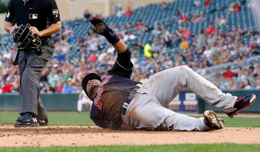 . Cleveland Indians\' Edwin Encarnacion scores on a hit by Melky Cabrera during the fourth inning of a baseball game Thursday, May 31, 2018, in Minneapolis. (AP Photo/Jim Mone)