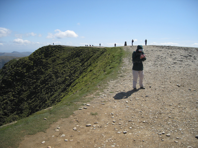 Martin checks his GPS on Hellvellyn summit