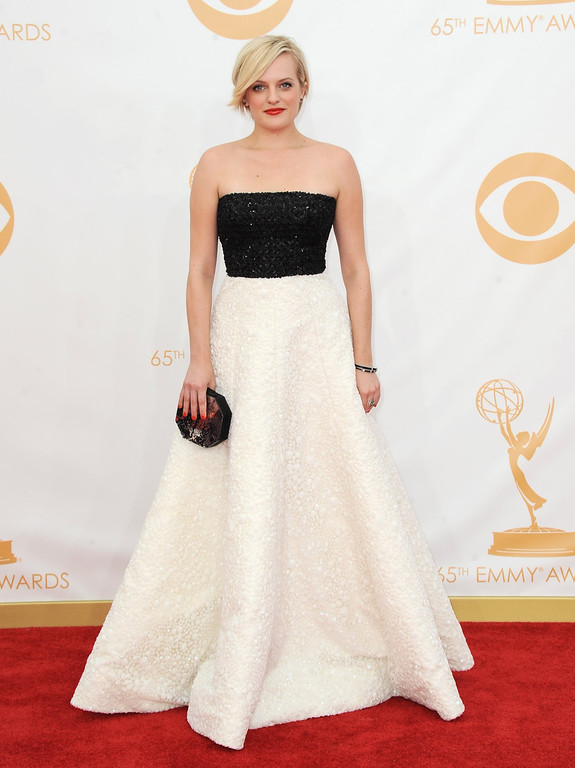 . Elisabeth Moss arrives at the 65th Primetime Emmy Awards at Nokia Theatre on Sunday Sept. 22, 2013, in Los Angeles.  (Photo by Jordan Strauss/Invision/AP)