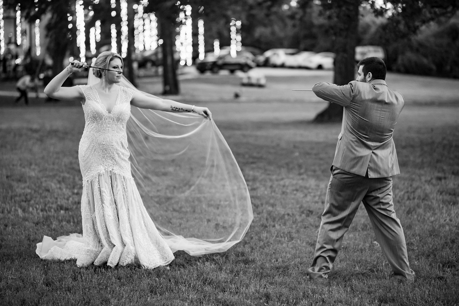bride and goom enact a wizard's duel on their wedding night
