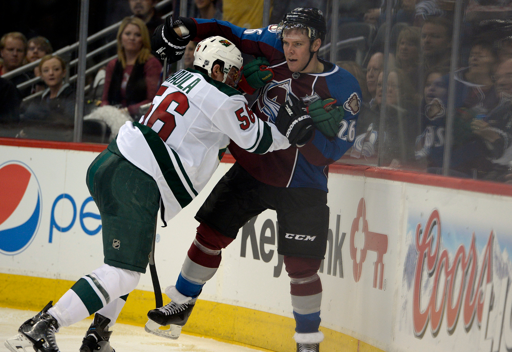 . Erik Haula (56) of the Minnesota Wild gets into a scuffle with Paul Stastny (26) of the Colorado Avalanche during the third period of action. The Colorado Avalanche hosted the Minnesota Wild for the first playoff game at the Pepsi Center on Thursday, April 17, 2014. (Photo by John Leyba/The Denver Post)