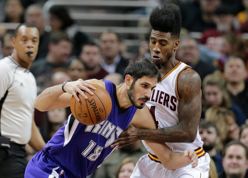 . Sacramento Kings\' Omri Casspi (18), from Israel, drives past Cleveland Cavaliers\' Iman Shumpert (4) in the first half of an NBA basketball game Monday, Feb. 8, 2016, in Cleveland. (AP Photo/Tony Dejak)