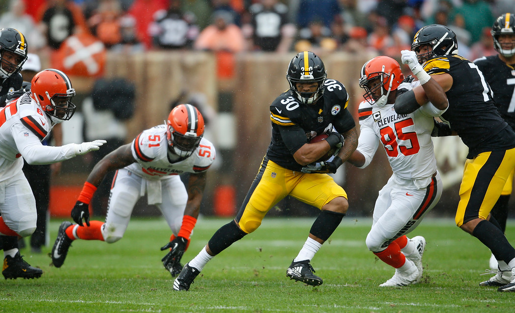 . Pittsburgh Steelers running back James Conner (30) rushes during the first half of an NFL football game against the Cleveland Browns, Sunday, Sept. 9, 2018, in Cleveland. (AP Photo/Ron Schwane)