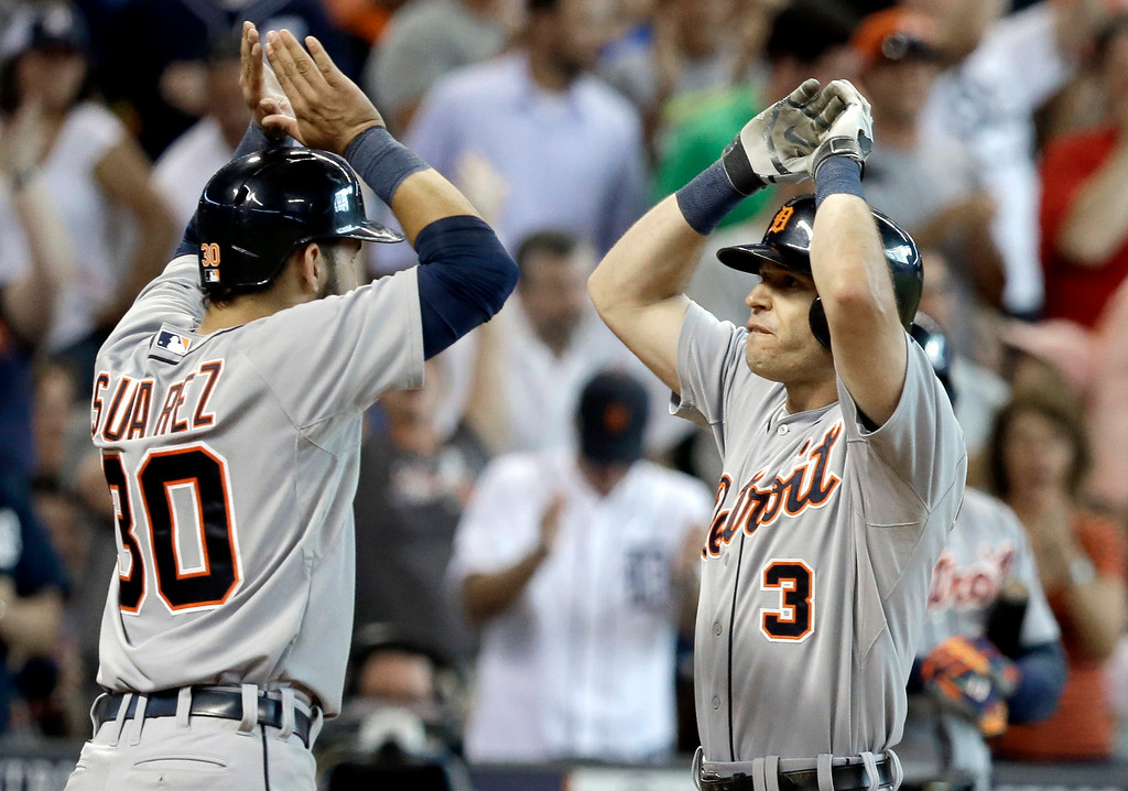 . Detroit Tigers\' Eugenio Suarez (30) welcomes Ian Kinsler (3) home after he hit a three-run homer against the Houston Astros in the ninth inning of a baseball game Saturday, June 28, 2014, in Houston. The Tigers won 4-3. (AP Photo/Pat Sullivan)
