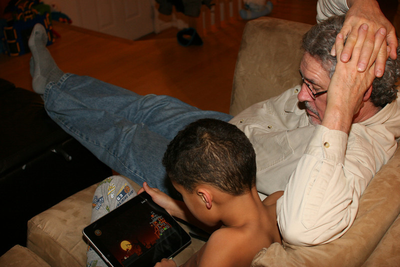 Granddad watches with too much interest.......