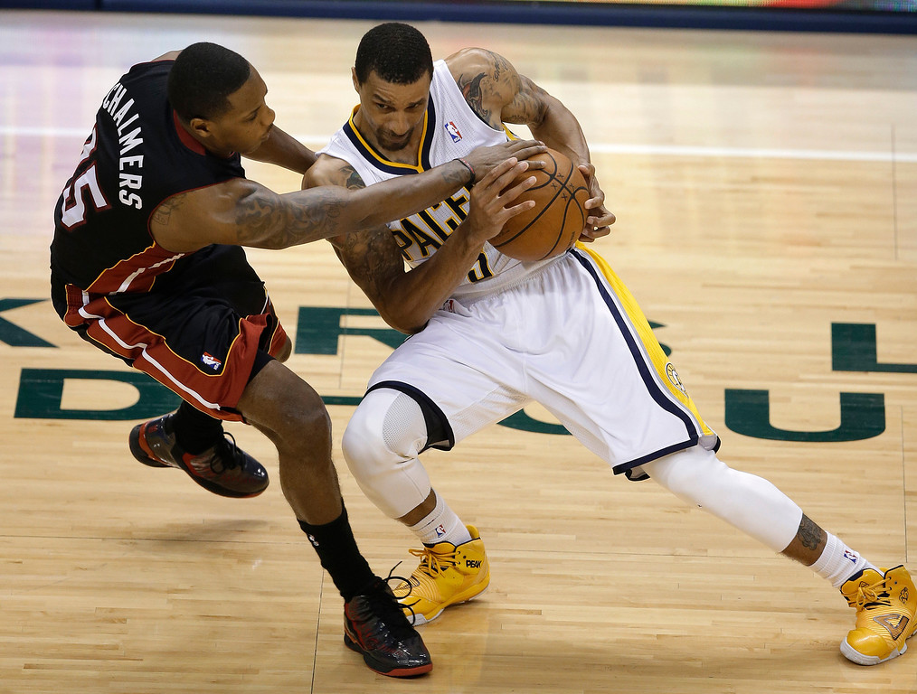 . Indiana Pacers\' George Hill is fouled by Miami Heat\'s Mario Chalmers during the first half of Game 5 of the Eastern Conference finals NBA basketball playoff series Wednesday, May 28, 2014, in Indianapolis. (AP Photo/Darron Cummings)