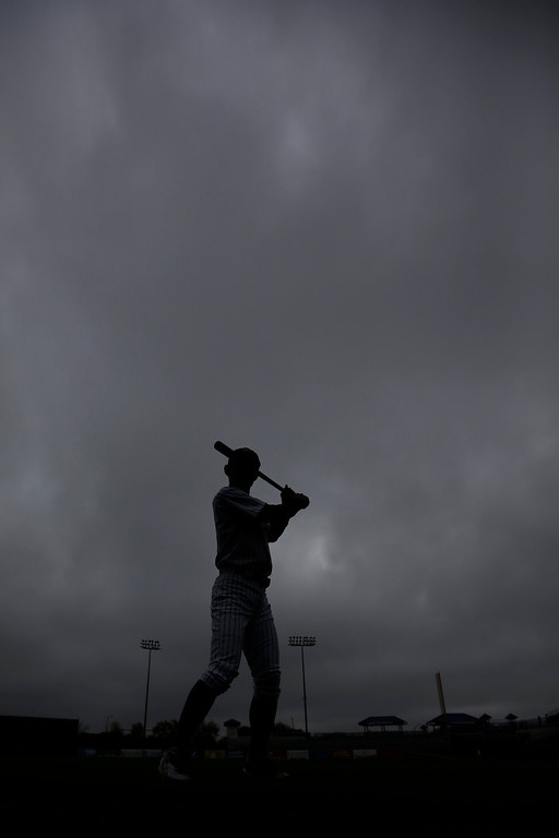 . New York Yankees right fielder Ichiro Suzuki, of Japan, poses for a photographer during the team\'s photo day at baseball spring training, Wednesday, Feb. 20, 2013, in Tampa, Fla. (AP Photo/Matt Slocum)