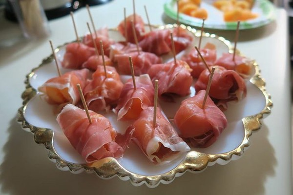 Prosciutto wrapped canteloupe.