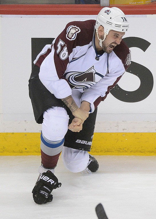 . Colorado wing Patrick Bordeleau held his wrist as he skated to the bench in the second period. The Minnesota Wild hosted the Colorado Avalanche at the Xcel Energy Center in St. Paul Monday night, April 21, 2014. (Photo by Karl Gehring/The Denver Post)