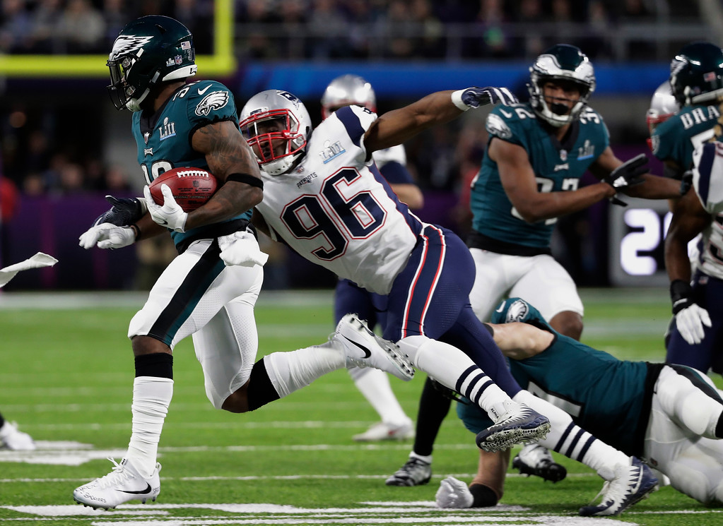 . New England Patriots\' Geneo Grissom (96) tries to tackle Philadelphia Eagles\' Corey Clement (30), on a kick off return during the first half of the NFL Super Bowl 52 football game, Sunday, Feb. 4, 2018, in Minneapolis. (AP Photo/Tony Gutierrez)