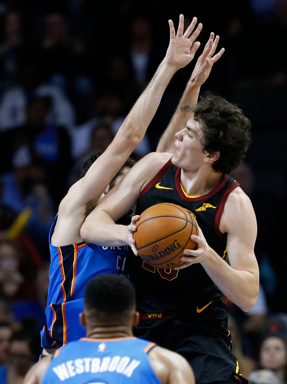 . Cleveland Cavaliers forward Cedi Osman, right, goes to the basket in front of Oklahoma City Thunder guard Alex Abrines, left, in the second half of an NBA basketball game in Oklahoma City, Tuesday, Feb. 13, 2018. (AP Photo/Sue Ogrocki)