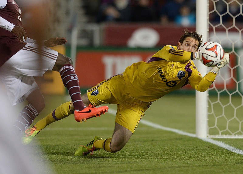. Montreal goalkeeper Troy Perkins made a save in the second half. The Colorado Rapids defeated the Montreal Impact 4-1 Saturday night, May 24, 2014. (Photo by Karl Gehring/The Denver Post)