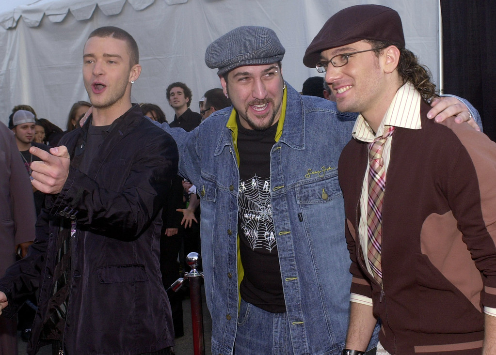 . Justin Timberlake, left, Joey Fatone, center, and JC Chasez, members of the pop group N\'Sync, joke around as they arrive at the 30th annual American Music Awards Monday, Jan. 13, 2003, in Los Angeles. (AP Photo/Reed Saxon)