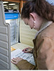 WOMAN MARKS BALLOT AT POLLING STATION IN DETROIT