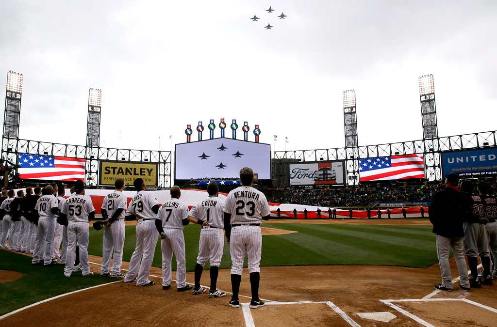 . Military Jets fly over before an opening day baseball game between the Cleveland Indians and the Chicago White Sox, Friday, April 8, 2016, in Chicago. (AP Photo/Nam Y. Huh)