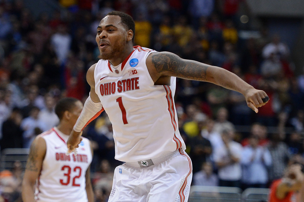 . Deshaun Thomas #1 of the Ohio State Buckeyes reacts late in the second half after LaQuinton Ross #10 makes a three-pointer against the Arizona Wildcats during the West Regional of the 2013 NCAA Men\'s Basketball Tournament at Staples Center on March 28, 2013 in Los Angeles, California.  (Photo by Harry How/Getty Images)