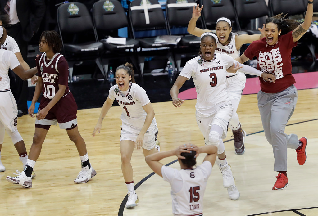 . South Carolina players celebrate their win over Mississippi State in the championship game of NCAA women\'s Final Four college basketball tournament, Sunday, April 2, 2017, in Dallas. South Carolina won 67-55. (AP Photo/Eric Gay)