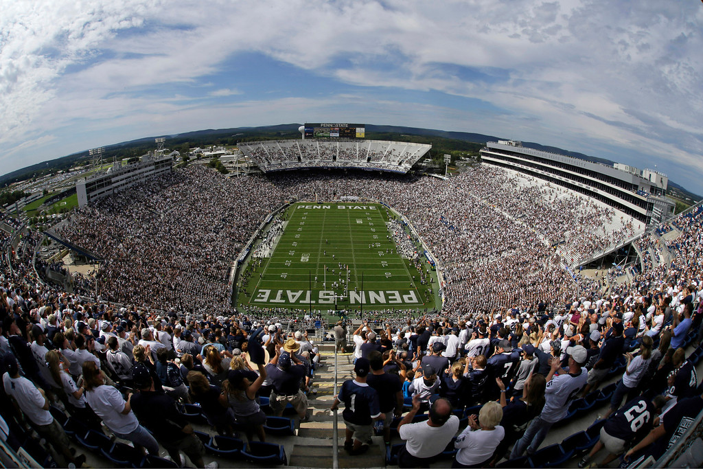 . College football fans watch the fourth quarter of an NCAA college football game between Penn State  and Eastern Michigan at Beaver Stadium in State College, Pa., Saturday, Sept. 7, 2013. Penn State won 45-7. (AP Photo/Gene J. Puskar)