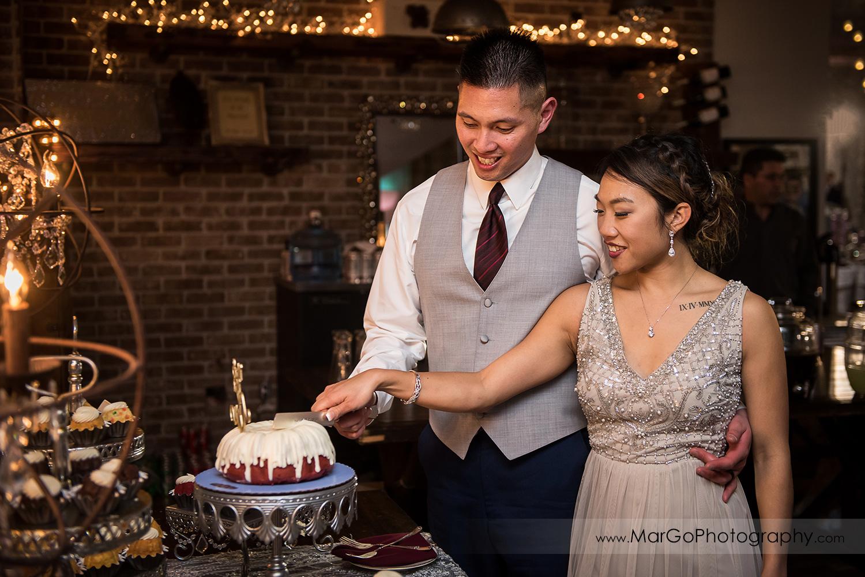 bride and groom cutting cake at Sunol's Casa Bella wedding reception
