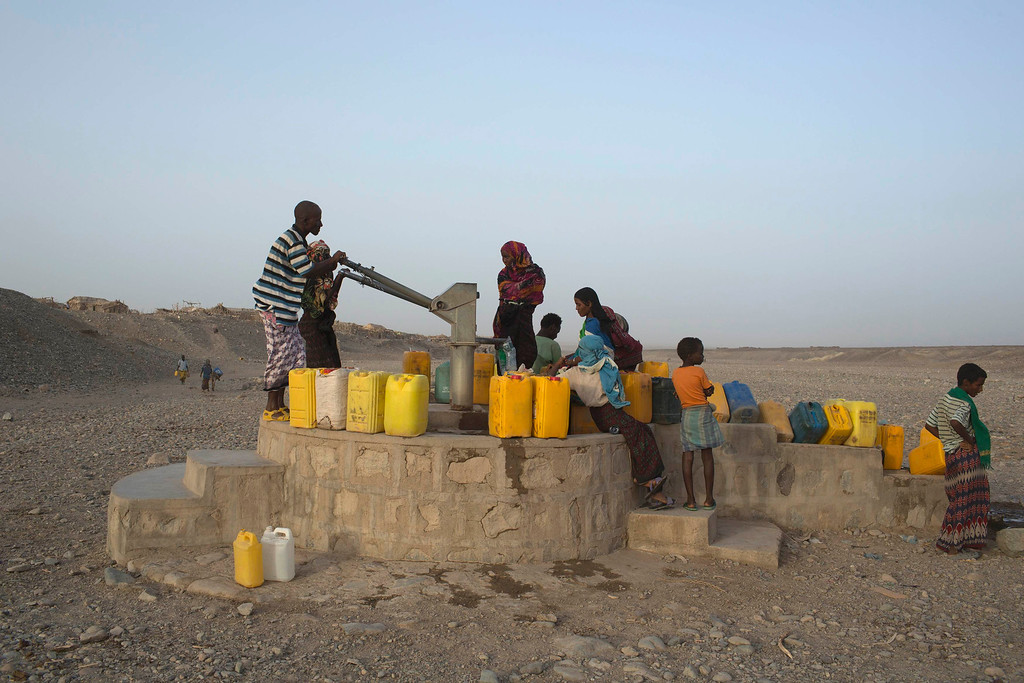 . Residents of Hamad-Ile pump water from a well in the Danakil Depression, northern Ethiopia April 21, 2013. The Danakil Depression in Ethiopia is one of the hottest and harshest environments on earth, with an average annual temperature of 94 degrees Fahrenheit (34.4 Celsius). For centuries, merchants have travelled there with caravans of camels to collect salt from the surface of the vast desert basin. The mineral is extracted and shaped into slabs, then loaded onto the animals before being transported back across the desert so that it can be sold around the country. Picture taken April 21, 2013. REUTERS/Siegfried Modola